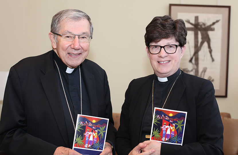 "ELCA Presiding Bishop Elizabeth A. Eaton (left) and Bishop Denis J. Madden, auxiliary bishop for the Archdiocese of Baltimore, hold copies of ""Declaration on the Way: Church, Ministry and Eucharist"""